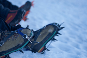 Different crampon styles for winter hiking
