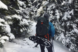 Hiking in the snow with backpack- large