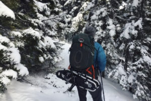 Hiking in the snow with backpack- thumb