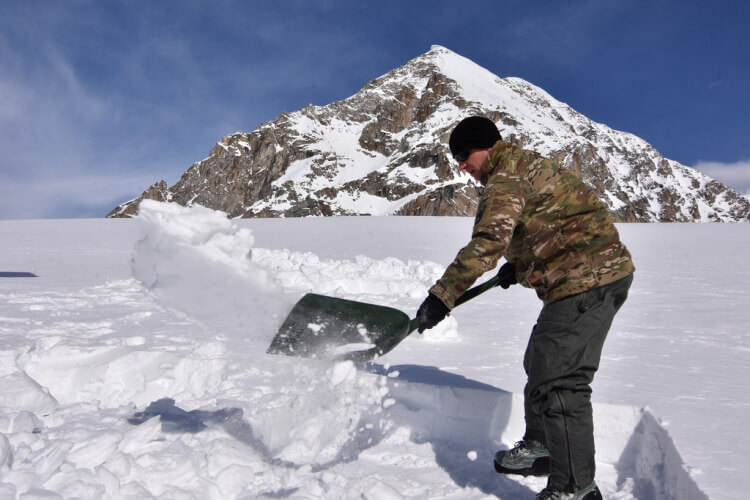 Shoveling snow with backpacking shovel