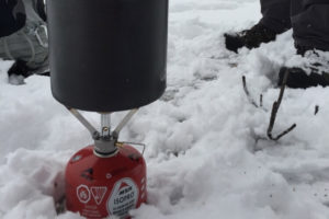 Winter camping stove in snow