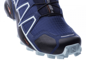Toe guard on trail running shoe
