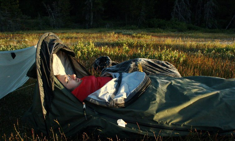 Man sleeping in bivy shelter