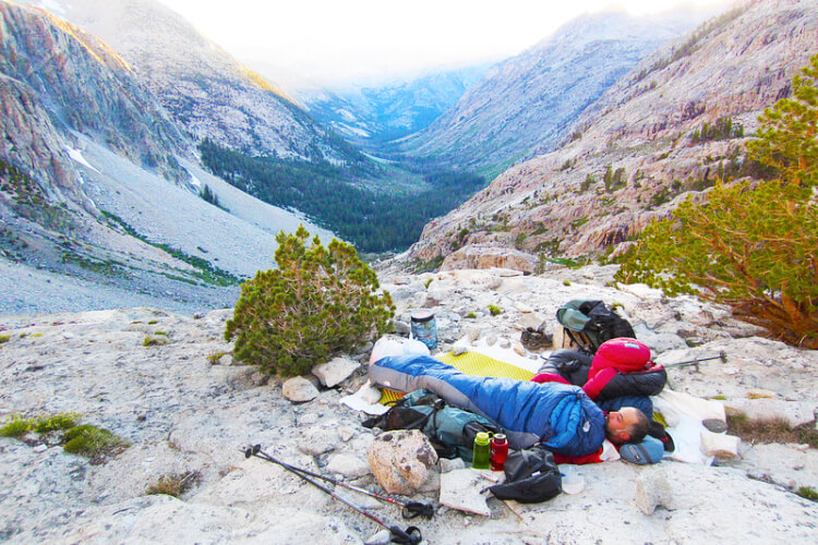 Backpackers camping in mountains without tent