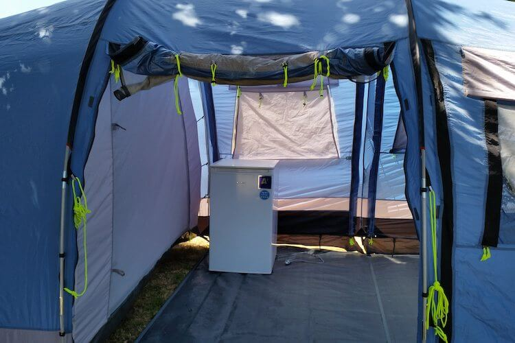 Mini fridge inside camping tent